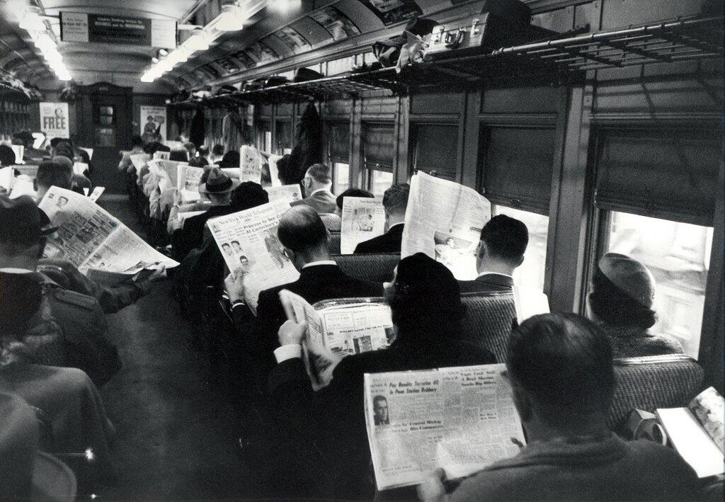 Liquid State - Black and white photo of passengers reading on the train